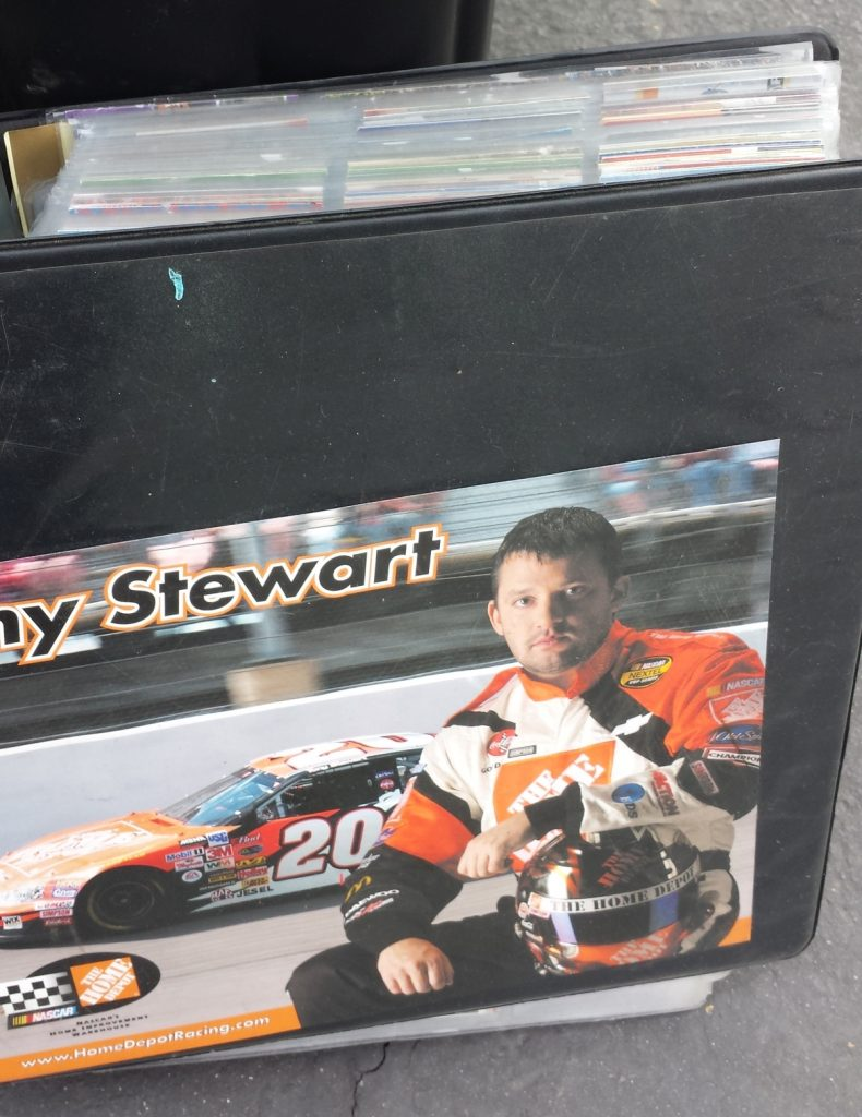 A binder of cards featuring NASCAR race driver Tony Stewart